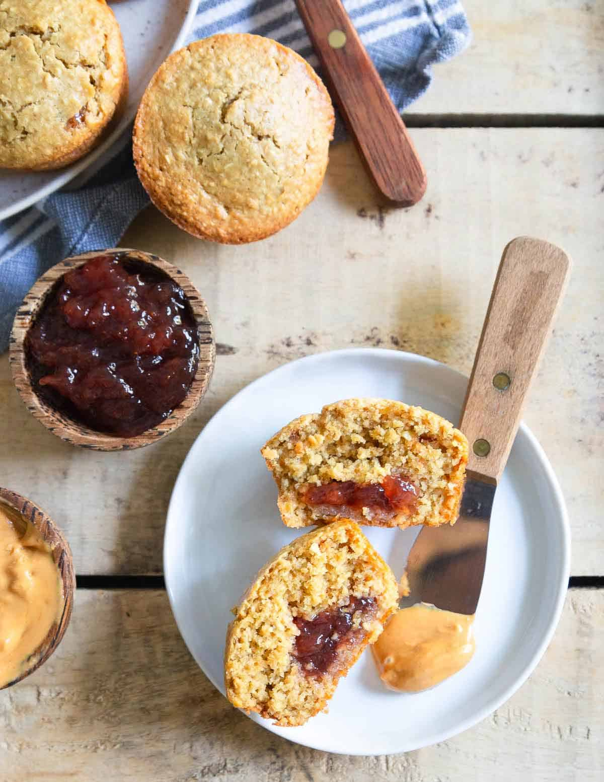 Peanut butter and jelly muffins made with gluten-free oat flour are a tasty afternoon treat!