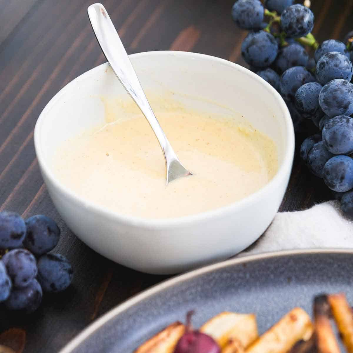 Sweetened with maple syrup and flavored with cinnamon and vanilla, this hummus dressing is the perfect sweet note drizzled on top of roasted parsnips.