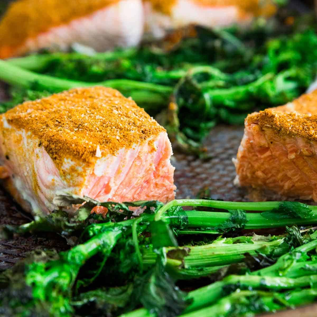 Sheet pan cinnamon turmeric wild salmon cooked with broccoli rabe on a sheet pan is a healthful dinner option and ready in no time!