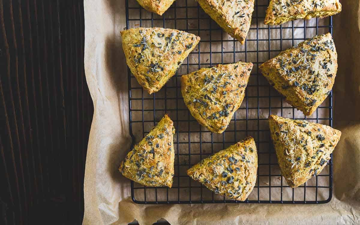 Hearty pumpkin scones filled with savory parmesan cheese, fresh herbs, pecans and pumpkin seeds.