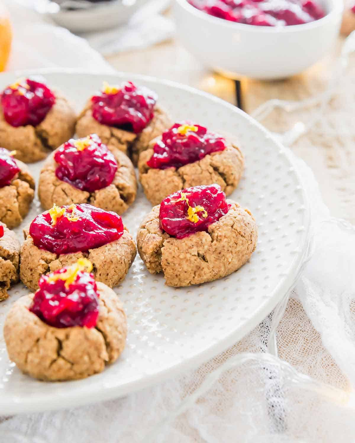 Thumbprint almond pulp cookies filled with an easy cranberry orange fruit jam.