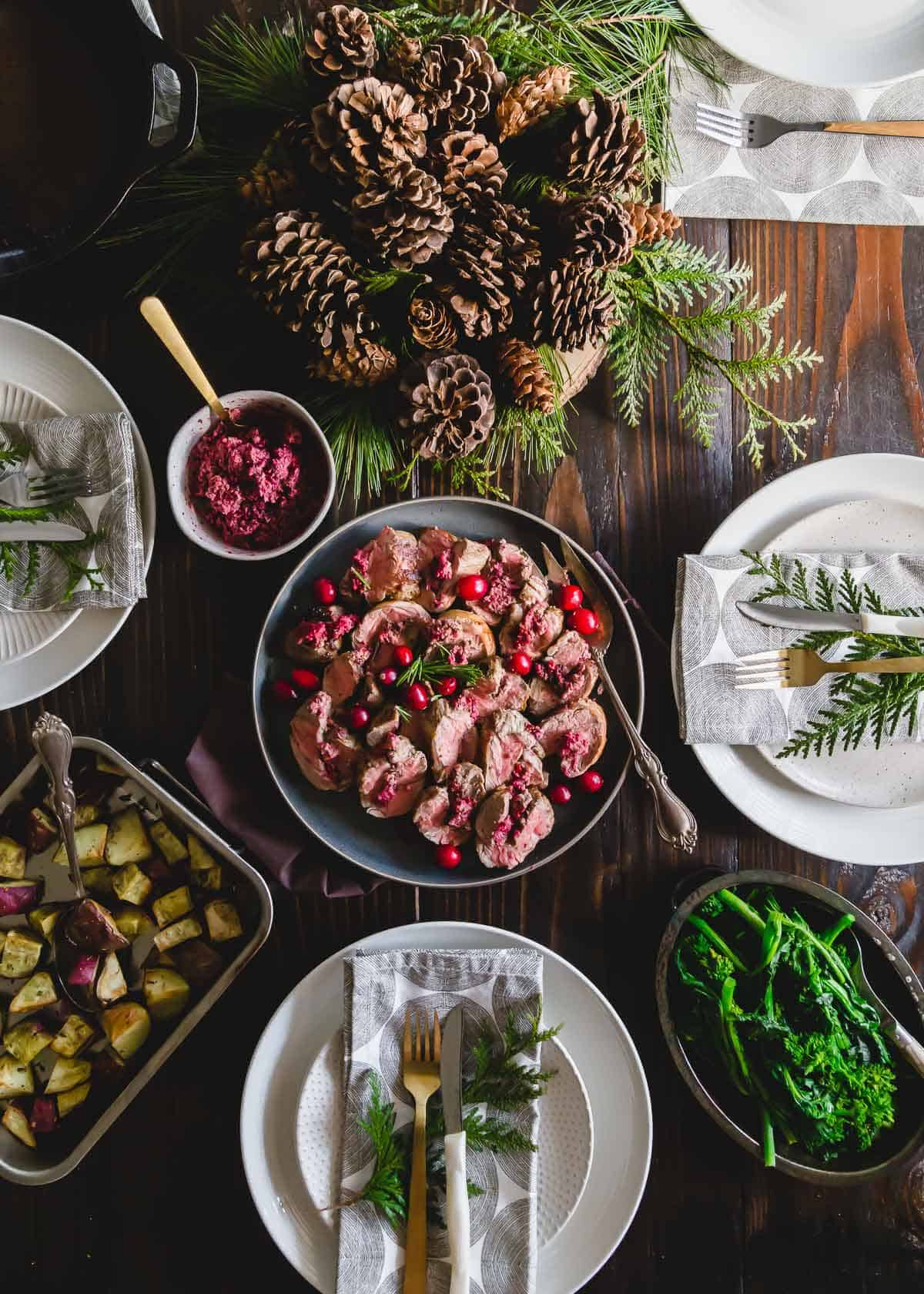 Cranberries make a bright and festive pesto for stuffing lamb in this easy holiday dinner recipe.