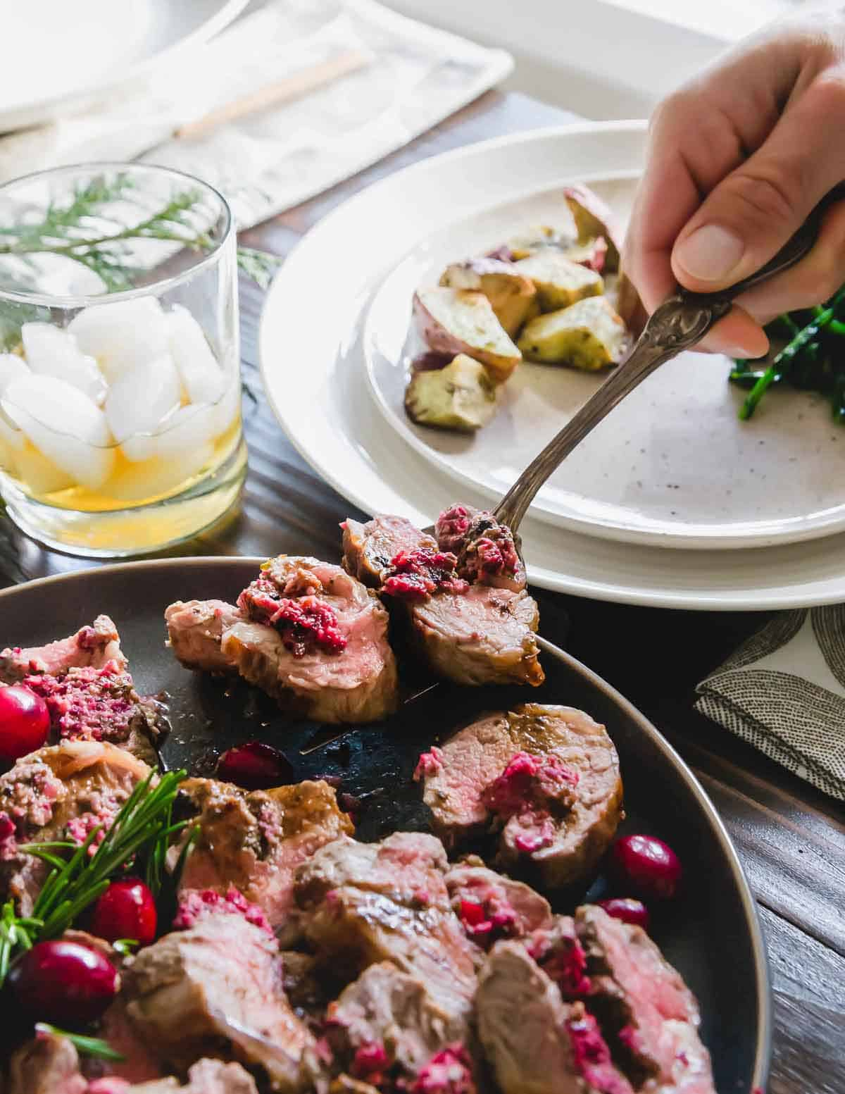 This stuffed lamb recipe uses lamb meat deboned from a rack of ribs and an easy to make cranberry pesto for bright, bold winter flavors.