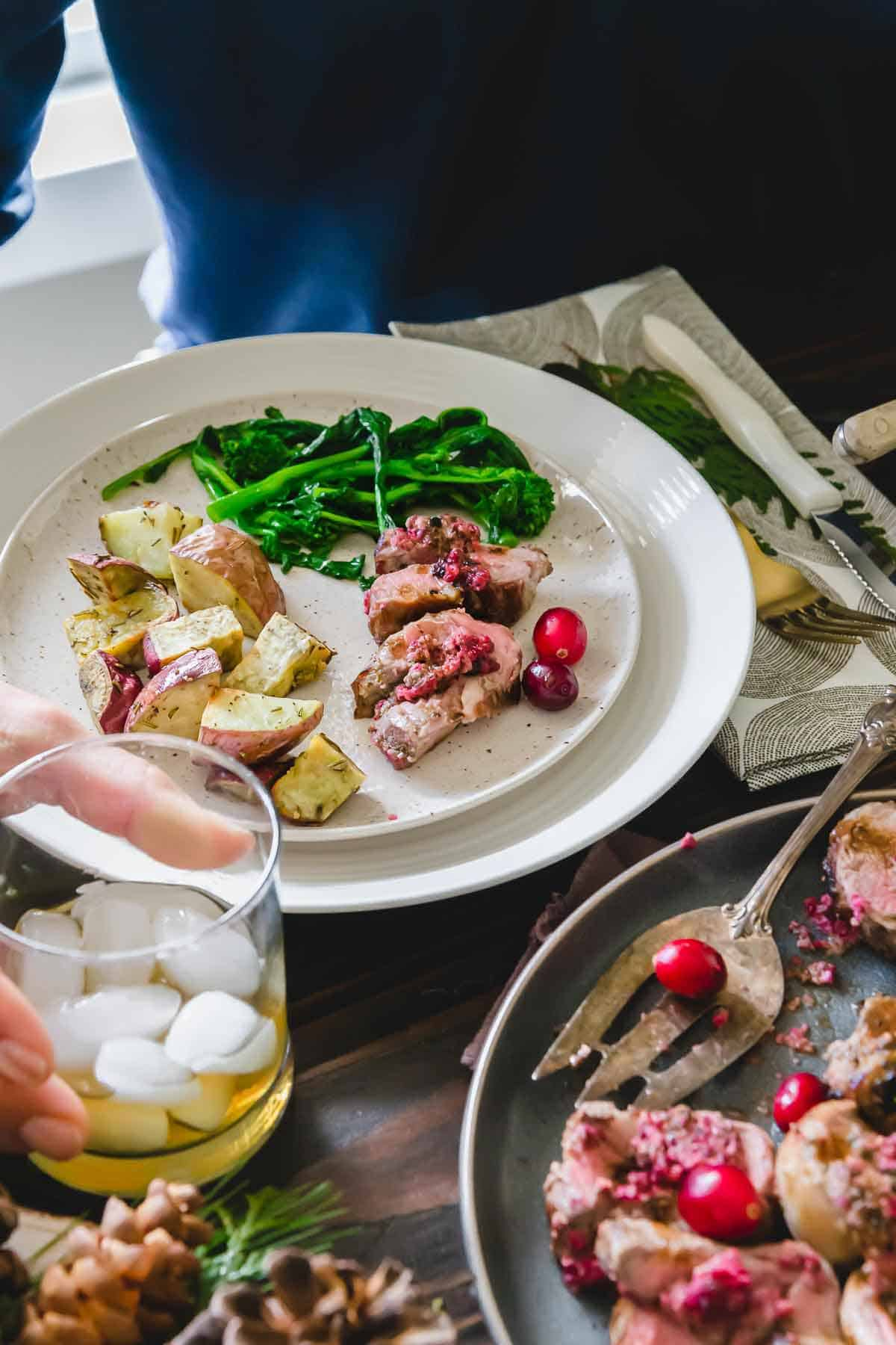Ditch the beef and try this easy to make stuffed lamb rolled with cranberry pesto for a stunning dinner party main dish.