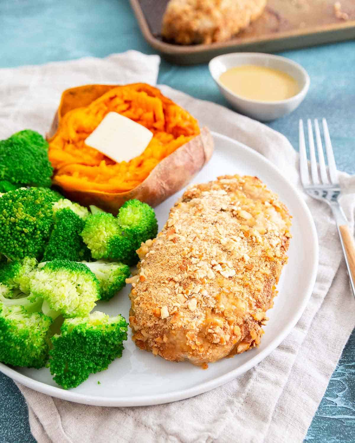 These baked pretzel crusted pork chops with an easy maple dijon sauce are an easy and healthy dinner packed with lean protein.