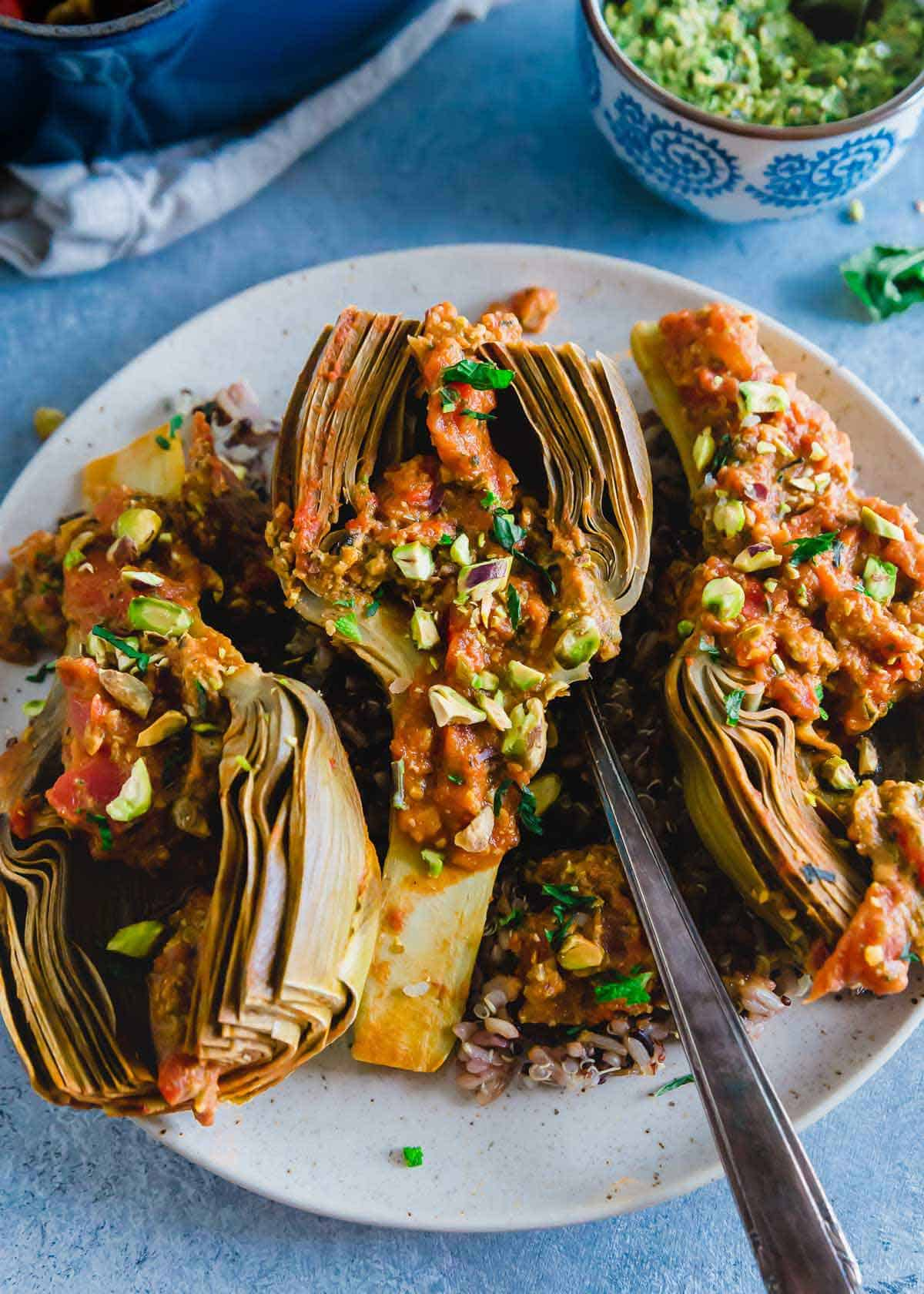 tomato braised artichokes with pistachio pesto