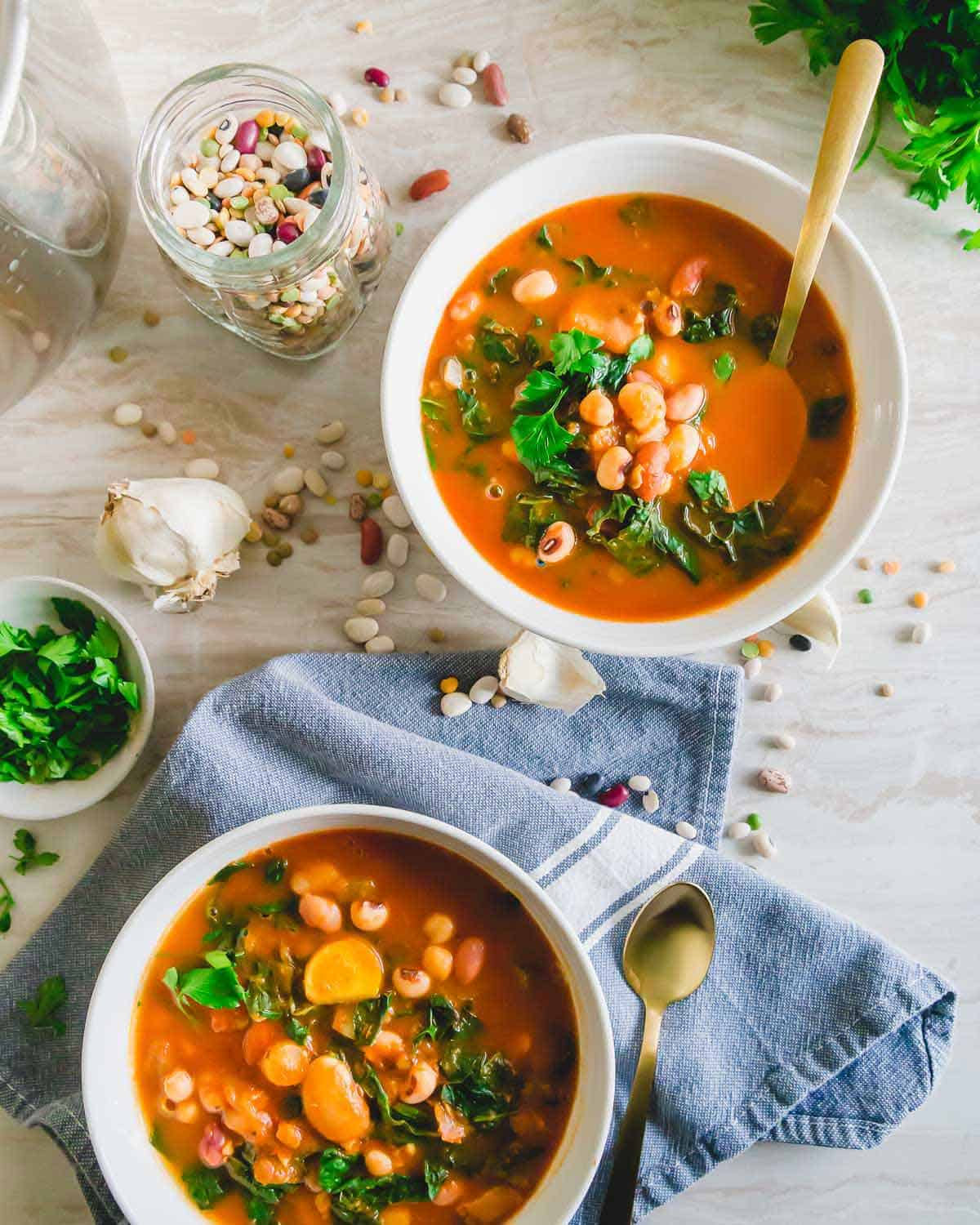 13 bean and lentil mixed soup made in the Instant Pot with kale and a brothy tomato base.