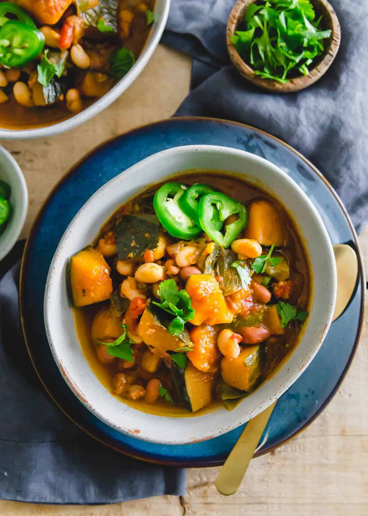 Hearty vegetarian chili with kabocha squash made in the slow cooker.