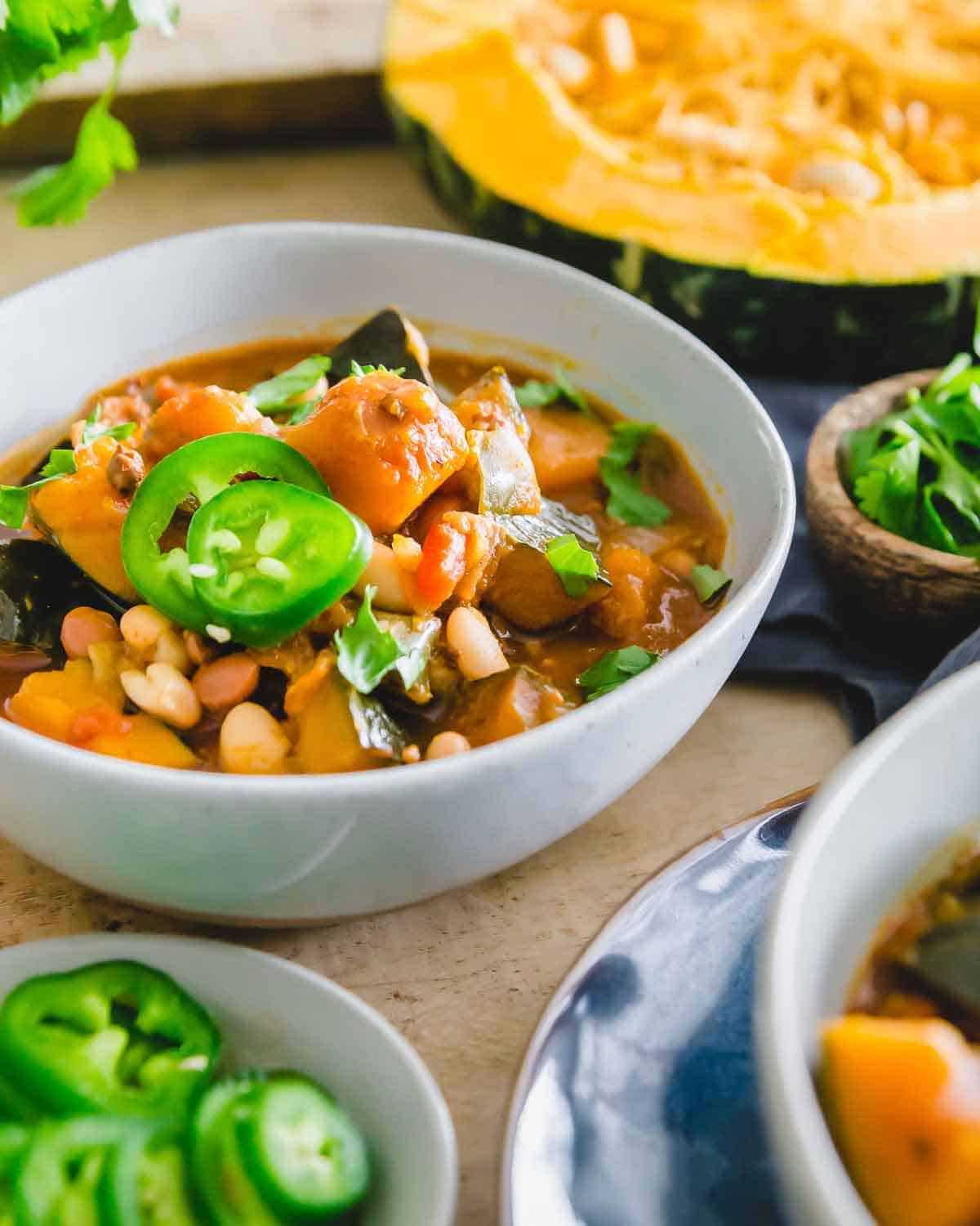 Kabocha squash chili with pinto and white beans is a filling and flavorful meal for the colder months.