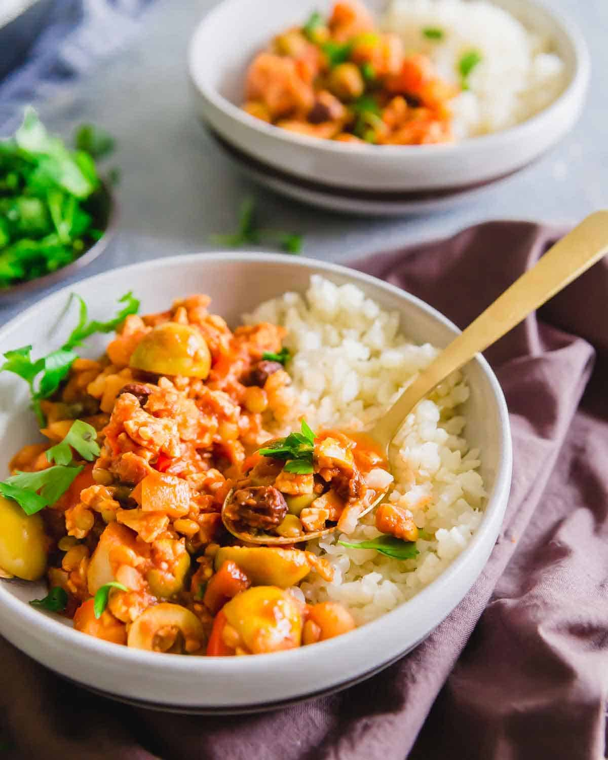 Vegan picadillo is a hearty Cuban recipe made with lentils and tempeh instead of the traditional beef for a plant based option.