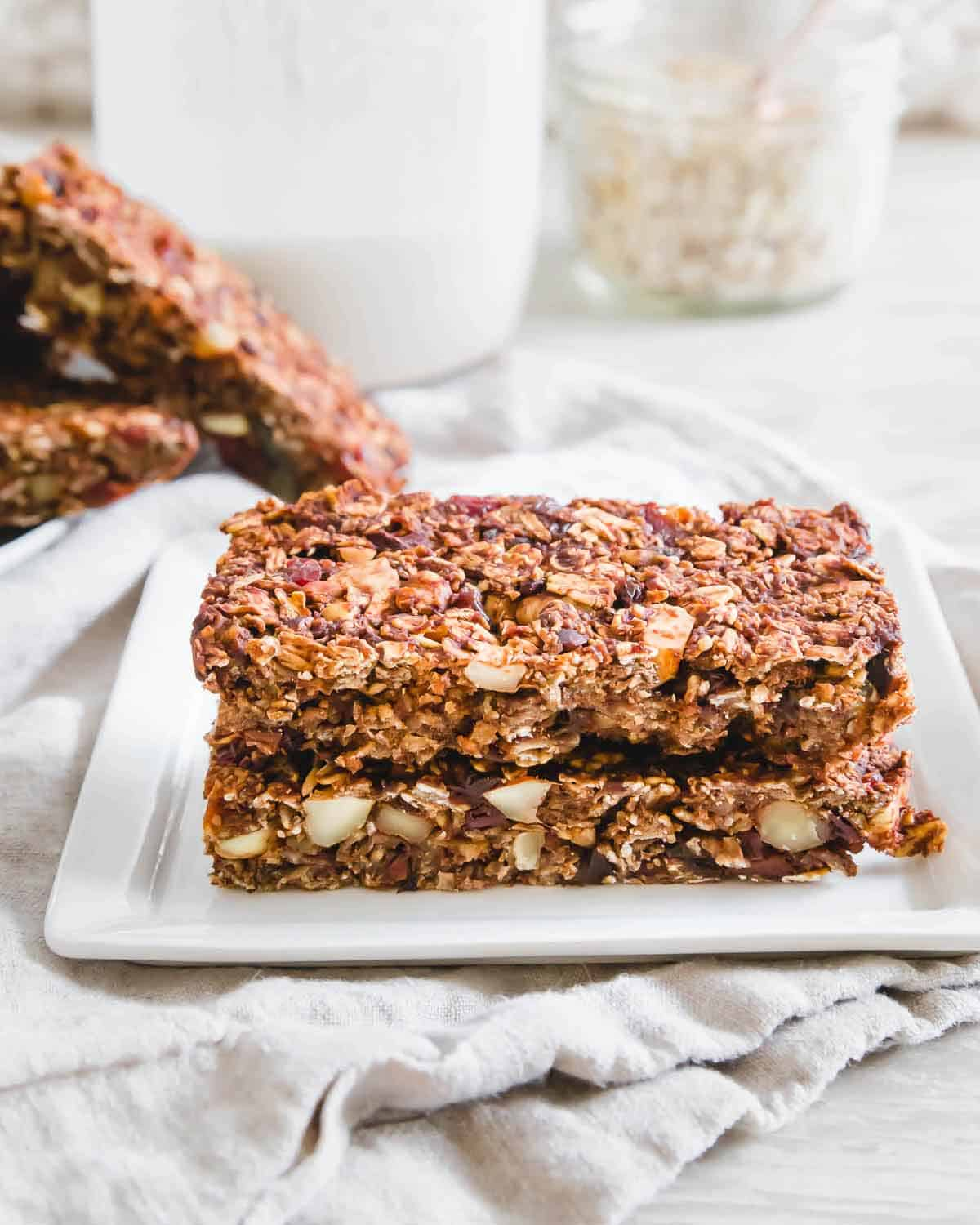 Filled with healthy oats, nuts and fruit, these chocolate granola bars are a nutritious snack.