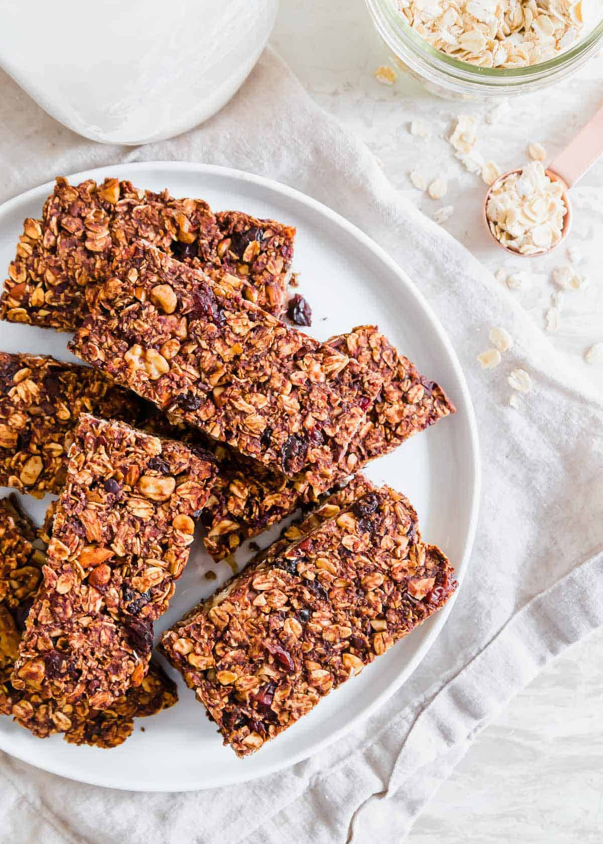 Healthy, oat-based and with no added sugar, these chocolate granola bars can be customized to your liking with add-ins for a nutritious gluten-free snack.