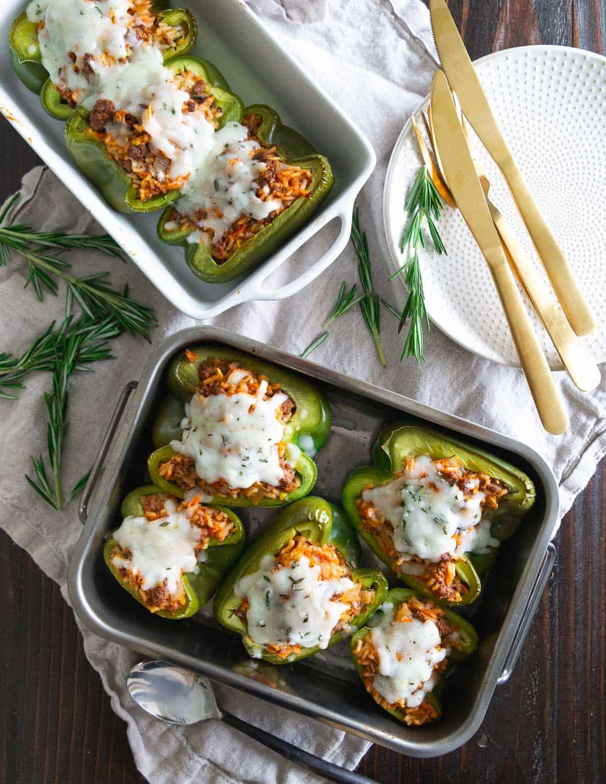 Easy stuffed pepper recipe with bison, rice and vegetables topped with melted cheddar cheese.