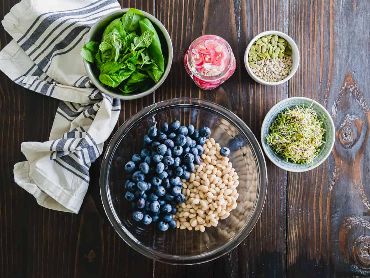 White bean and blueberry salad with pickled onions, seeds and fresh herbs.