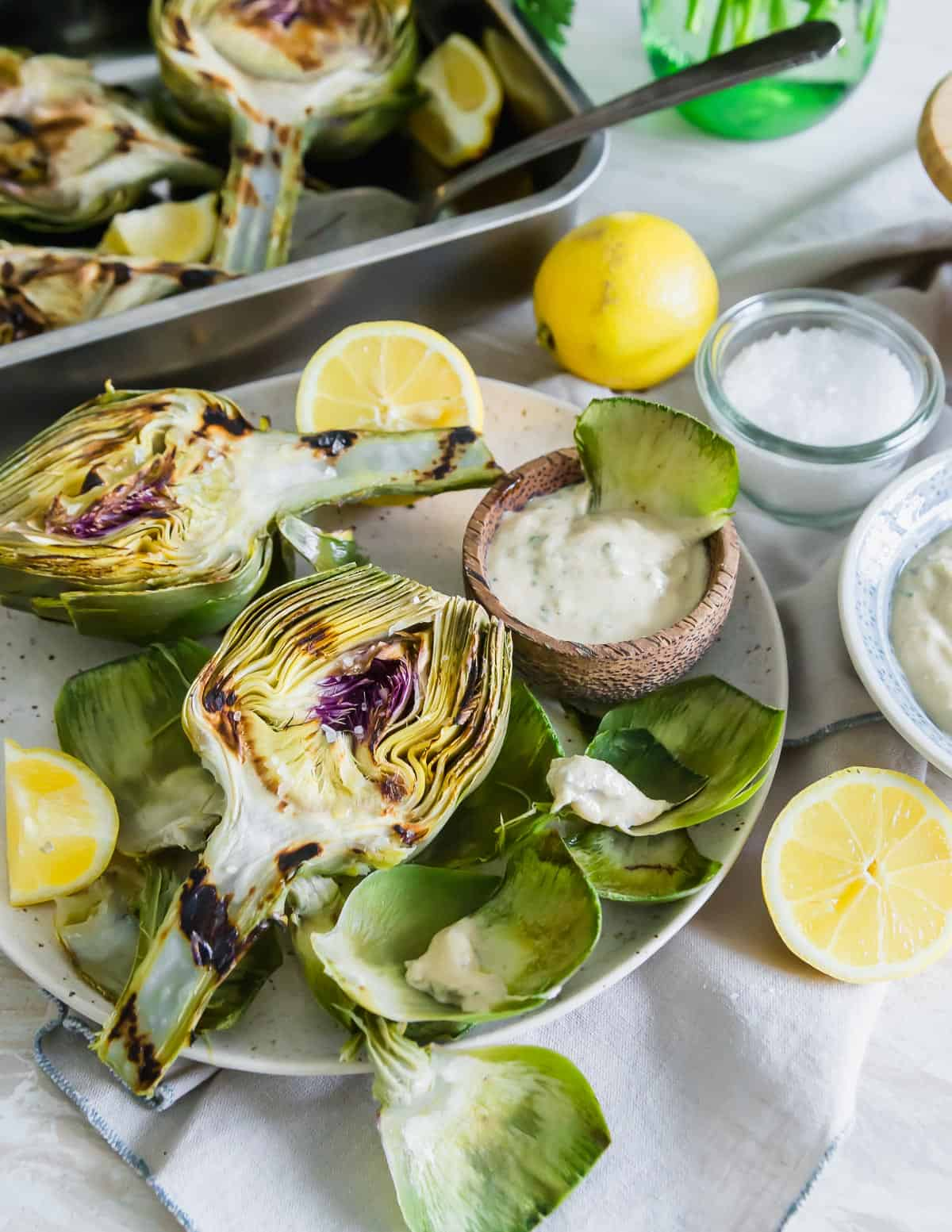 Grilling artichokes is a favorite easy way to enjoy one of the best vegetables spring has to offer.