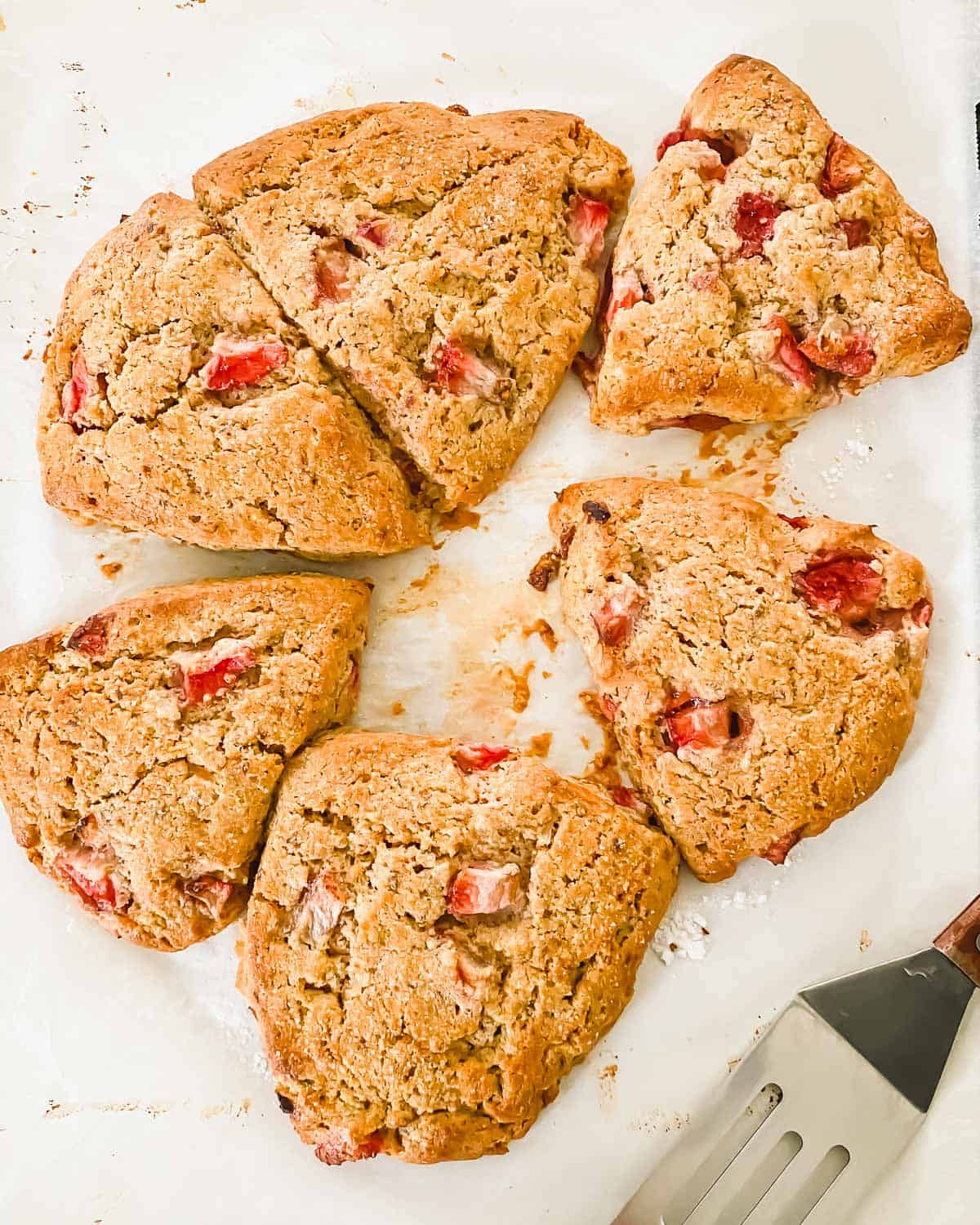 Tender and flaky strawberry lemon scones are brightly flavored and perfect for spring. Vegan, gluten-free, grain-free.