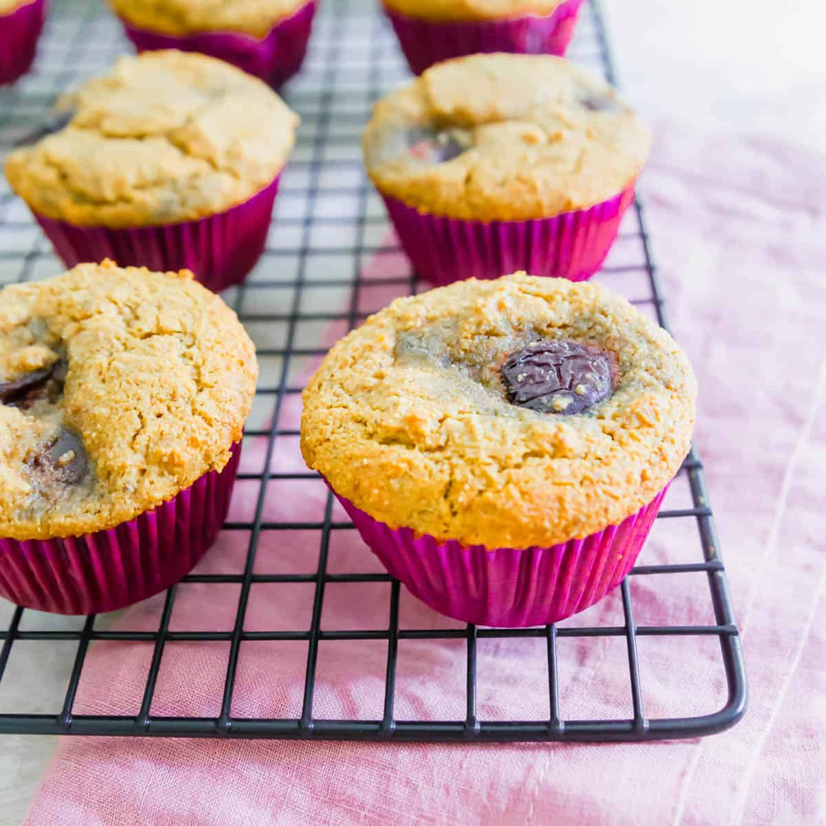 These vegan and gluten-free corn muffins are filled with whole fresh cherries and make a delicious summer baked good!