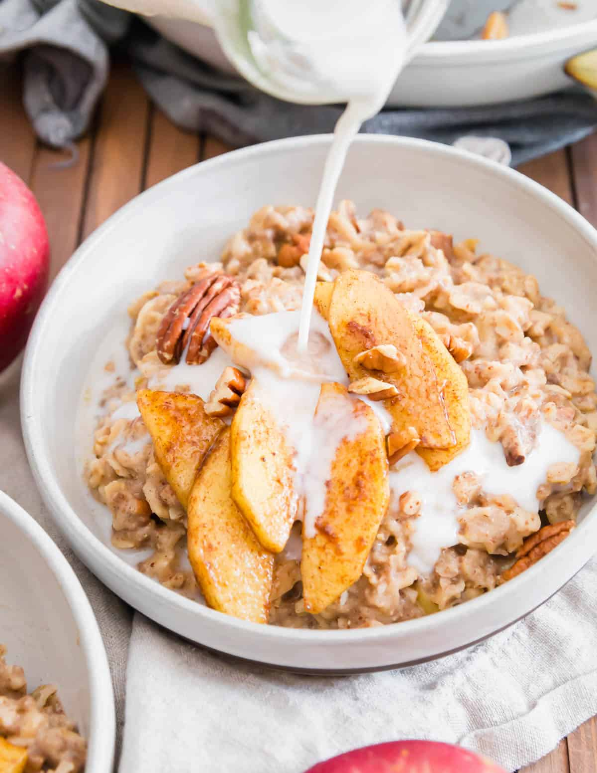 Add a splash of milk before serving this apple cinnamon oatmeal for a creamy and decadent tasting fall breakfast.