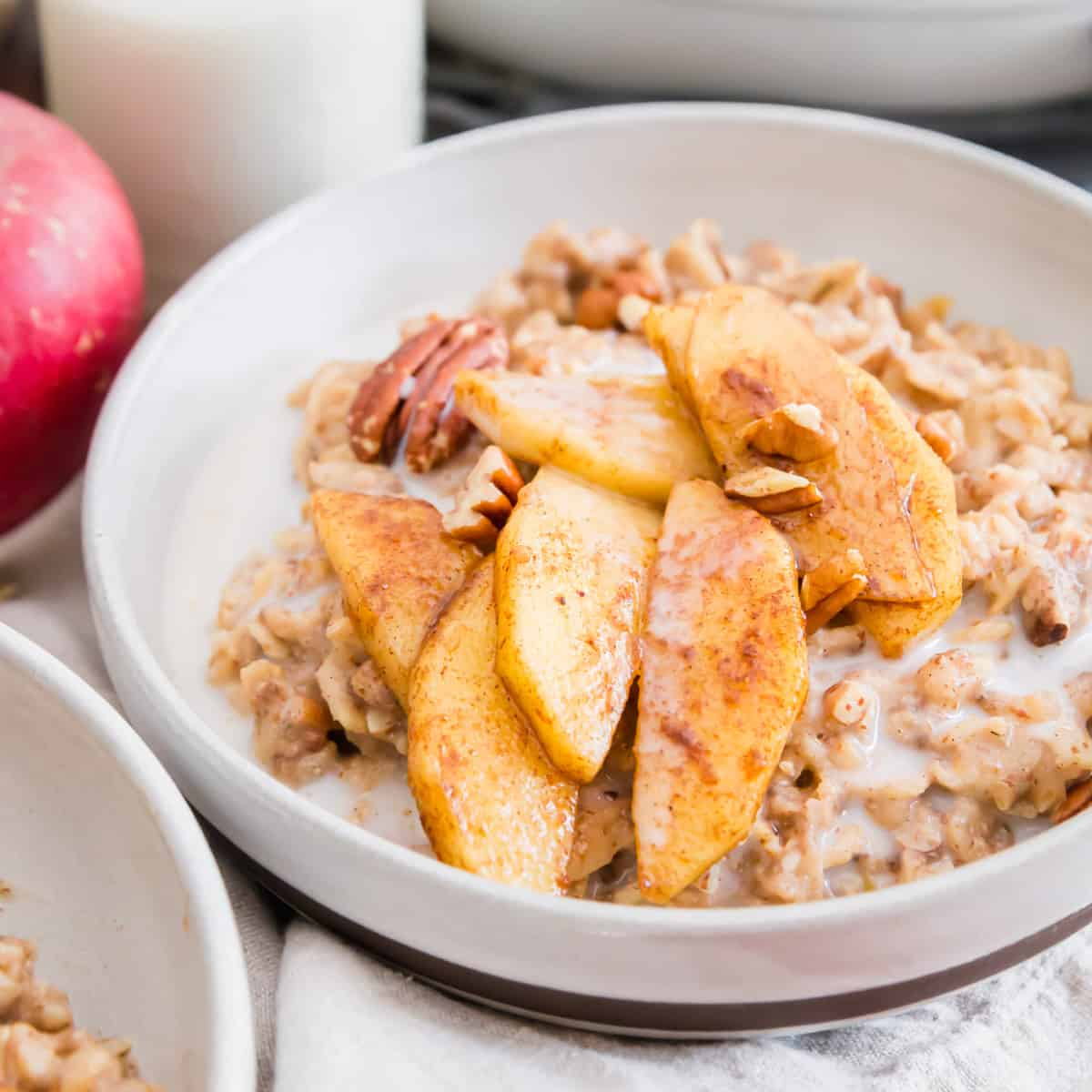 Apple cinnamon oatmeal made with gluten-free oats, chia seeds and flaxseed is a healthy yet creamy and decadent tasting fall breakfast.