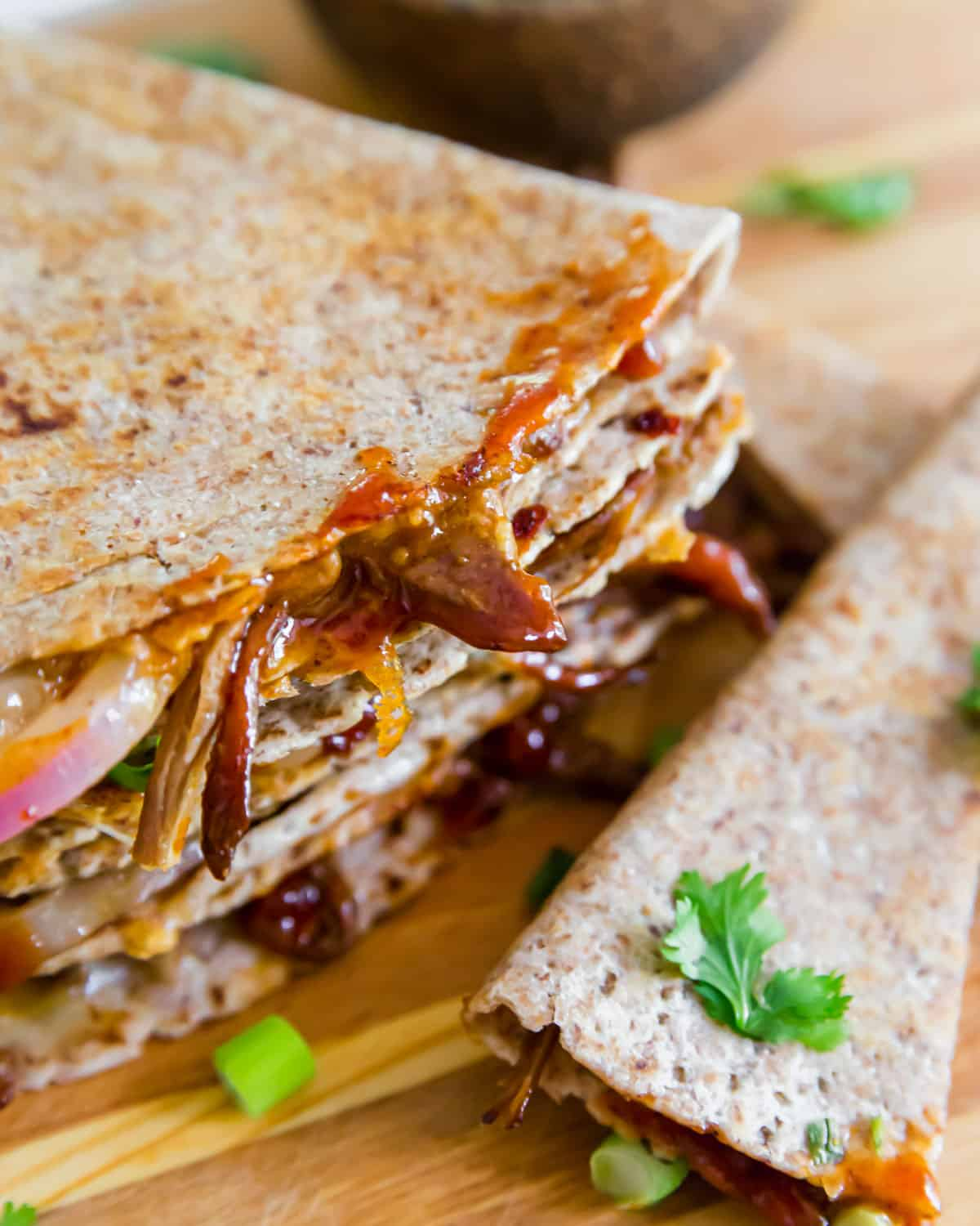 Use up leftover brisket in this simple brisket quesadilla recipe with BBQ sauce, red onions and cheddar cheese.