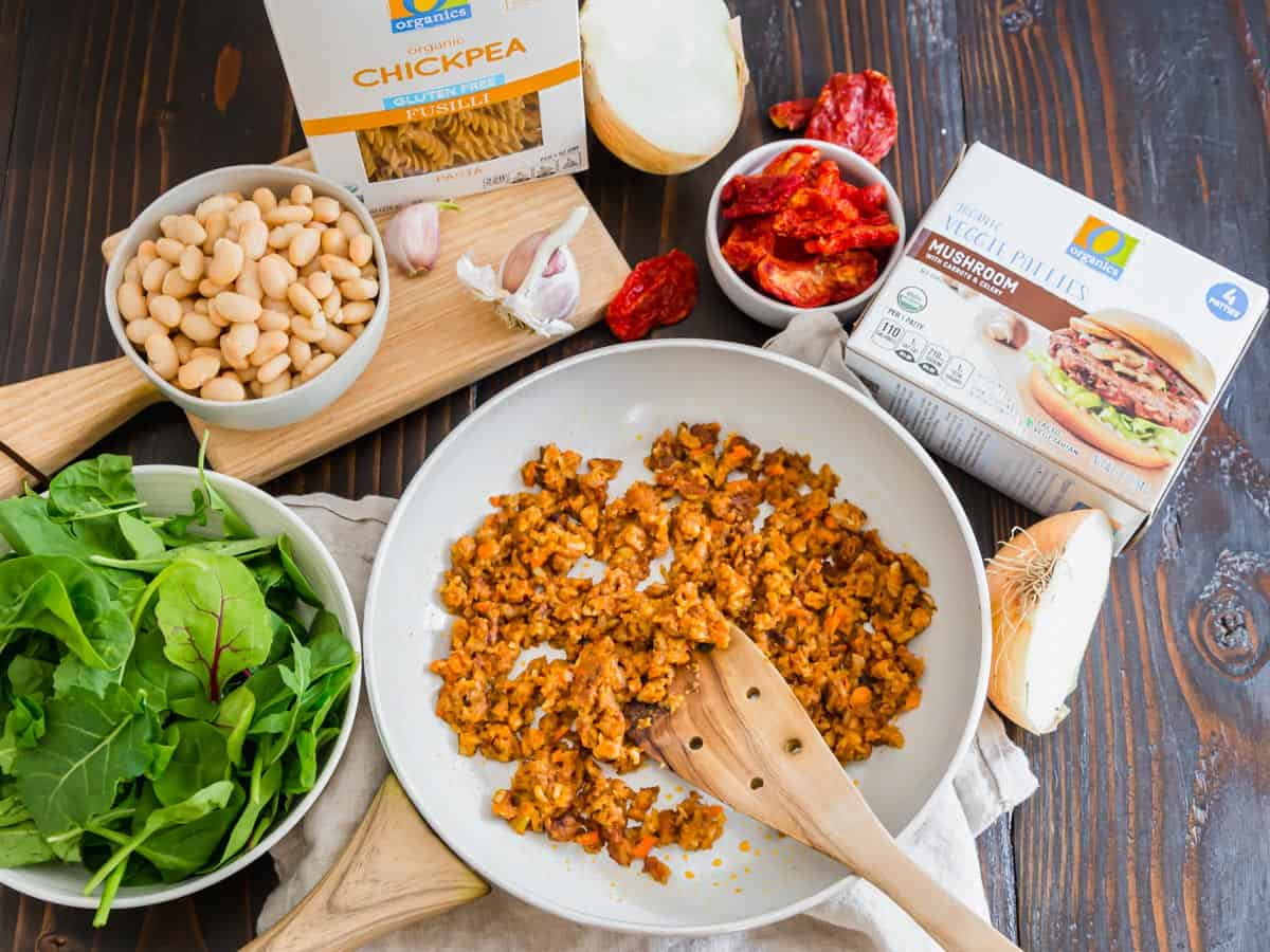 This vegetarian pasta includes sun-dried tomatoes, baby spinach greens, sautéed crumbled mushroom veggie burgers and a creamy white bean sauce.
