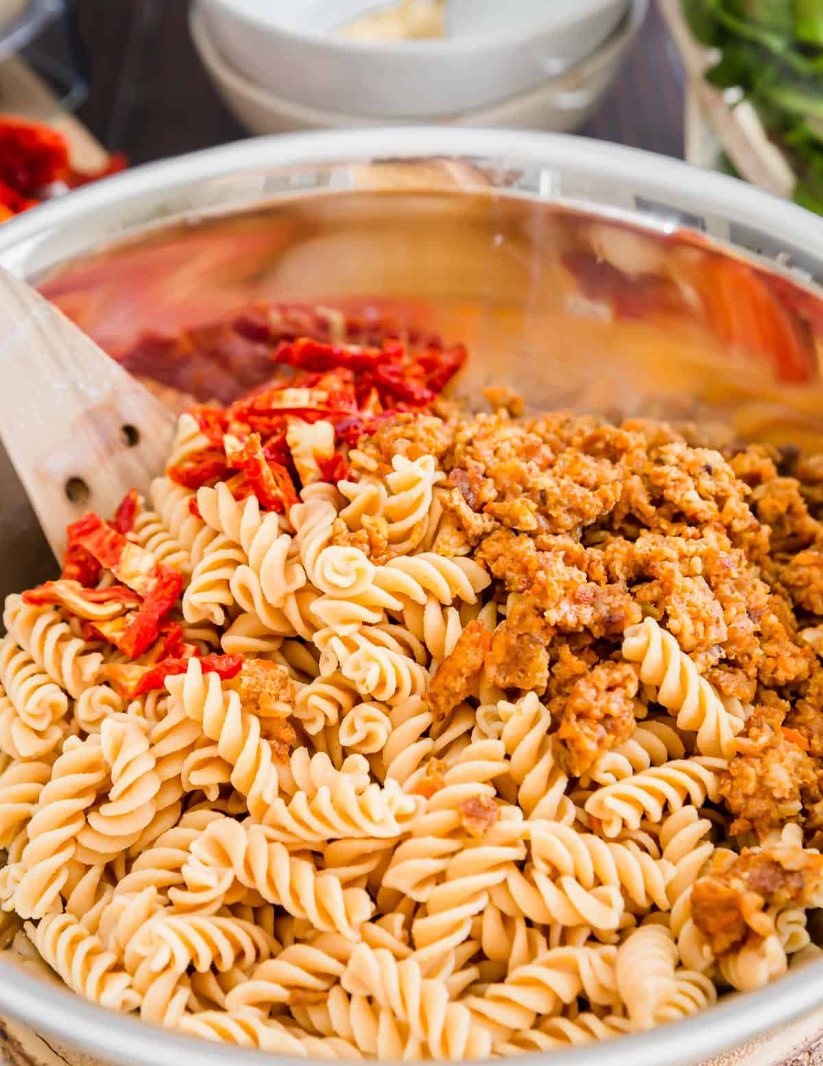 Sun-dried tomatoes and sautéed mushroom veggie burgers give this creamy white bean pasta tons of flavor and texture.