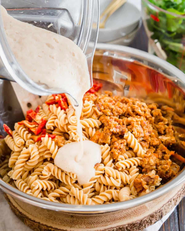 This luscious, creamy dairy free and vegan white bean sauce coats chickpea fusilli pasta.