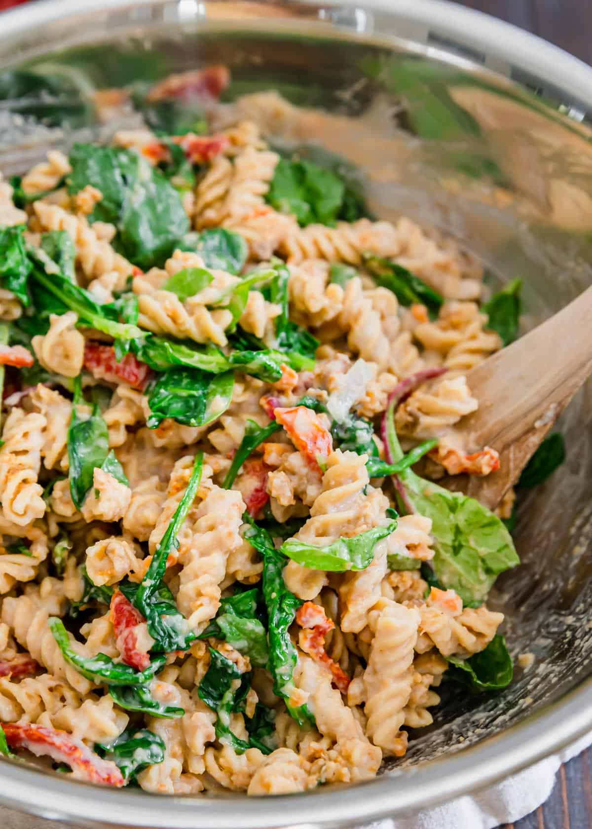 Baby spinach greens add a nice pop of color to this sun-dried tomato creamy white bean pasta recipe.