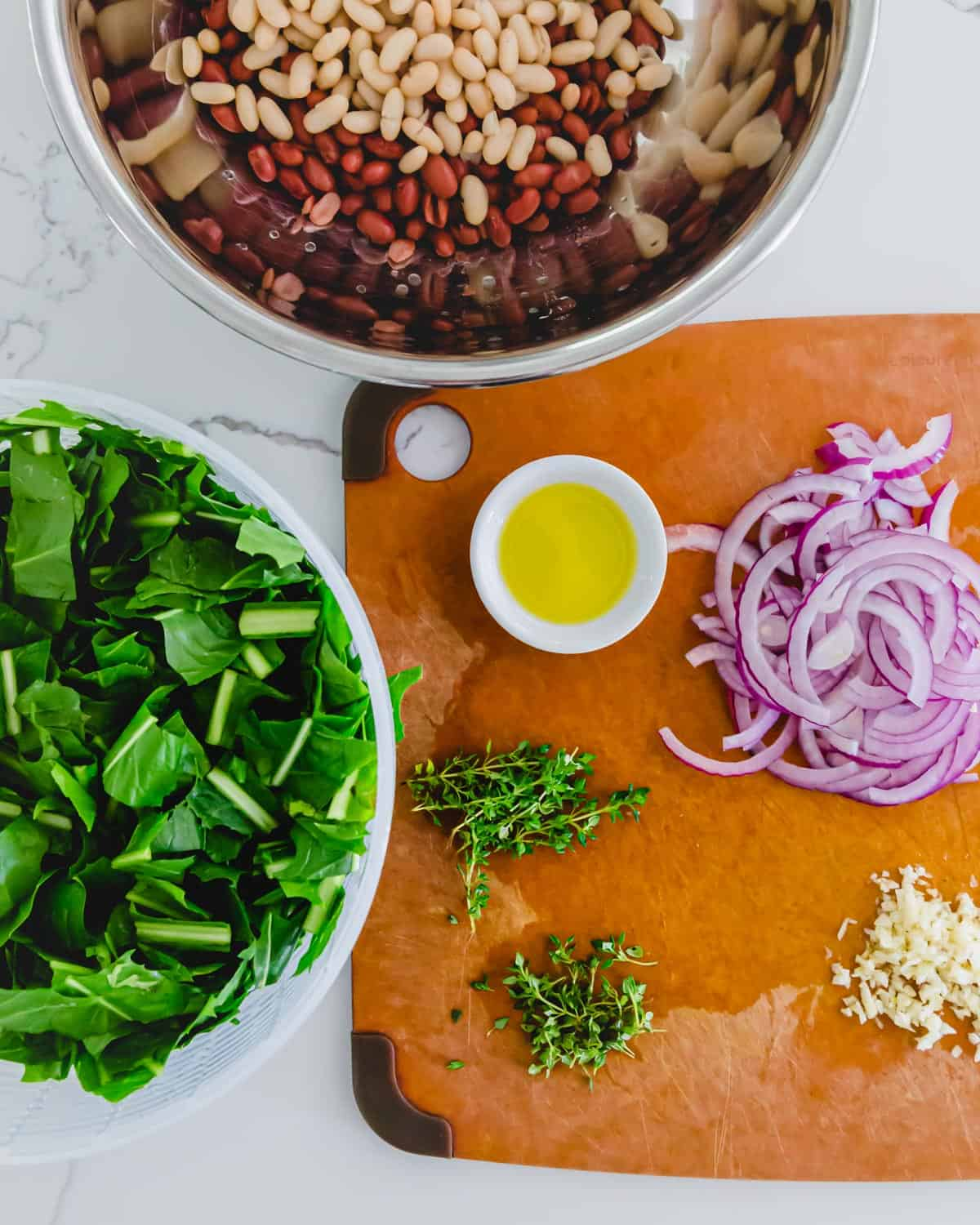 prepped ingredients for a vegetarian dandelion greens and beans skillet recipe
