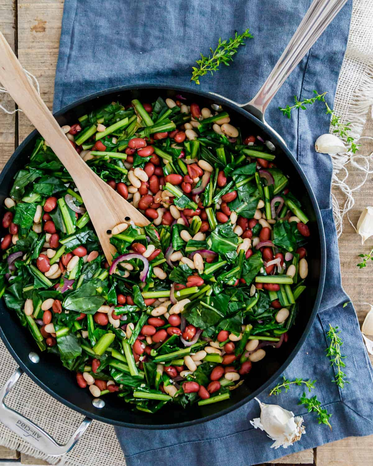 Sautéed dandelion greens with beans skillet recipe is an easy, meatless meal.