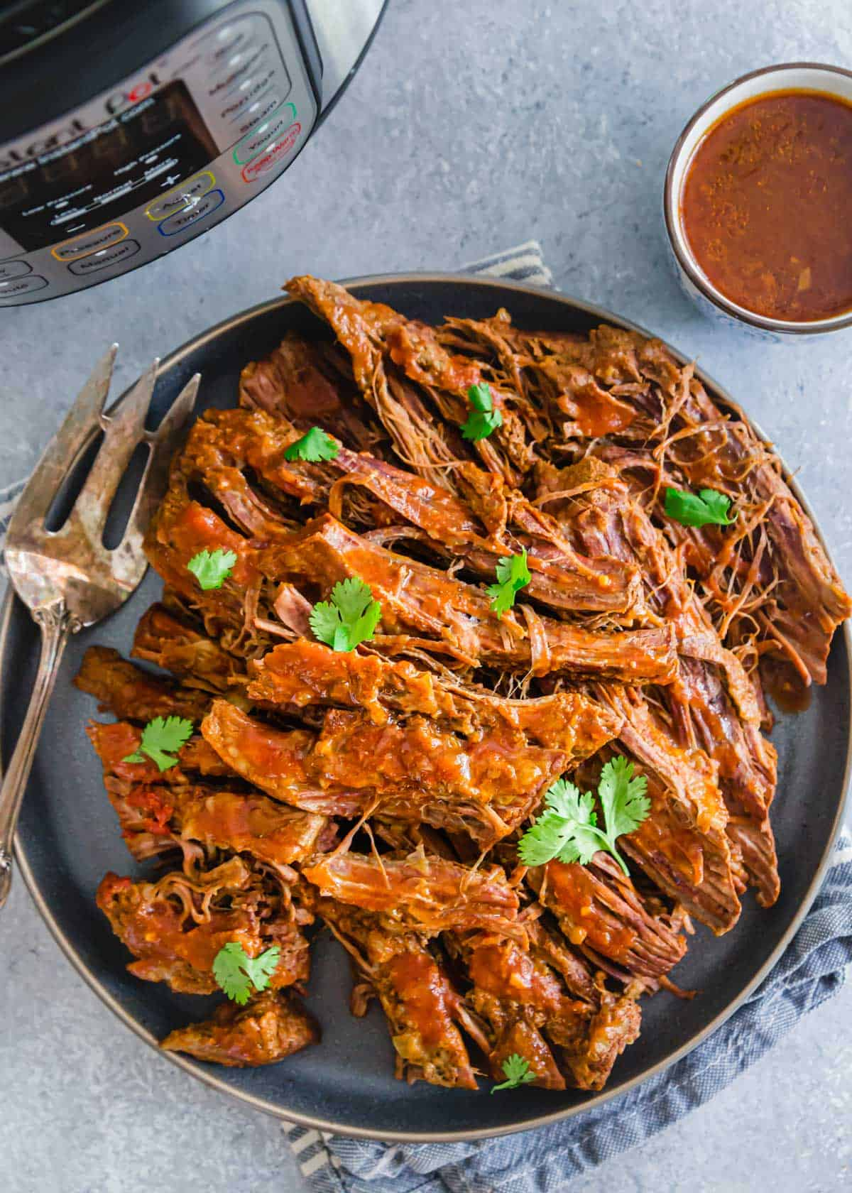 Easy Instant Pot brisket recipe with BBQ sauce.