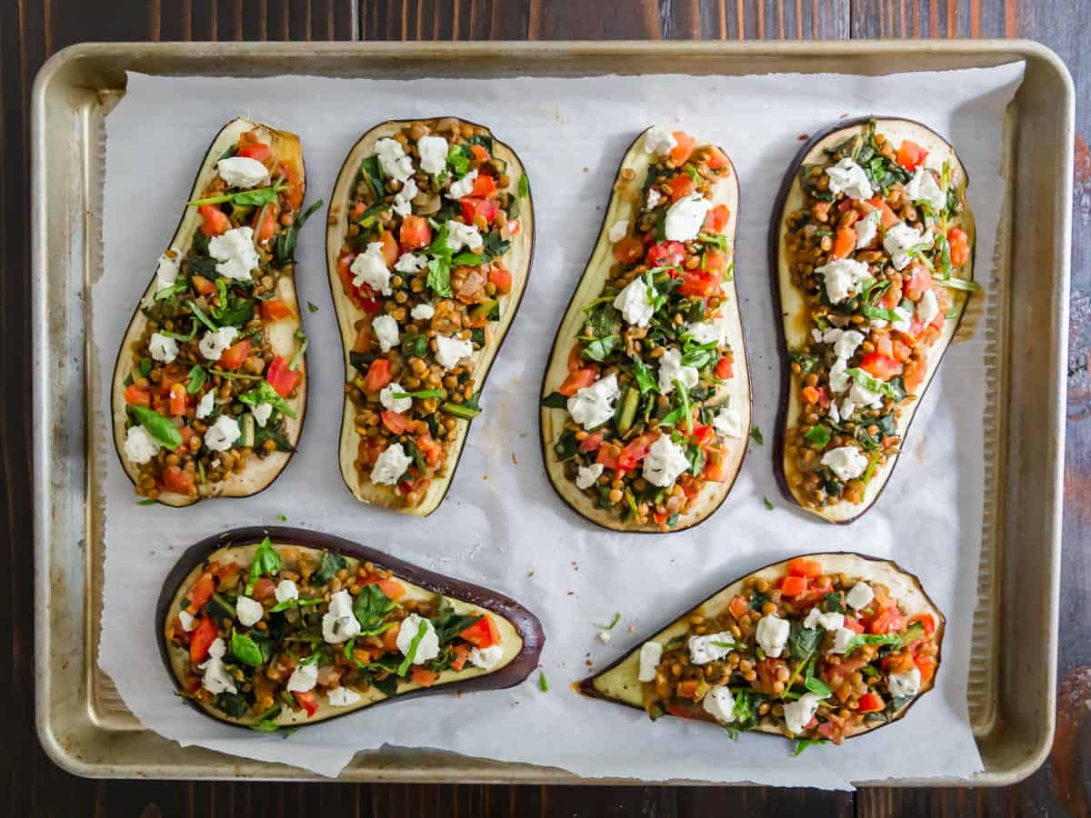 Eggplant slices topped with a lentil, tomato, greens stuffing and dollops of goat cheese.