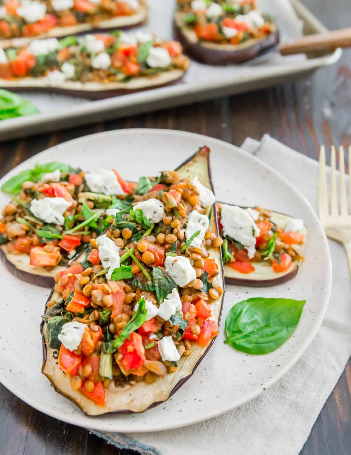 Eggplant slices stuffed with a vegetarian mixture of lentils, tomatoes, greens and goat cheese.