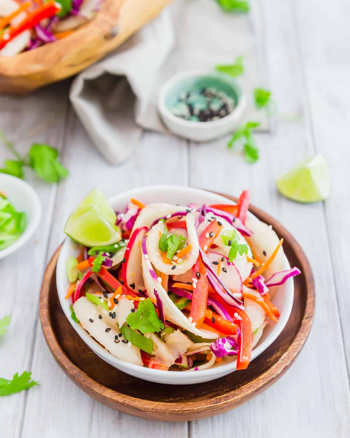 Bright colorful vegetables and kohlrabi noodles make a deliciously healthy vegetarian salad dressed with a Thai vinaigrette.