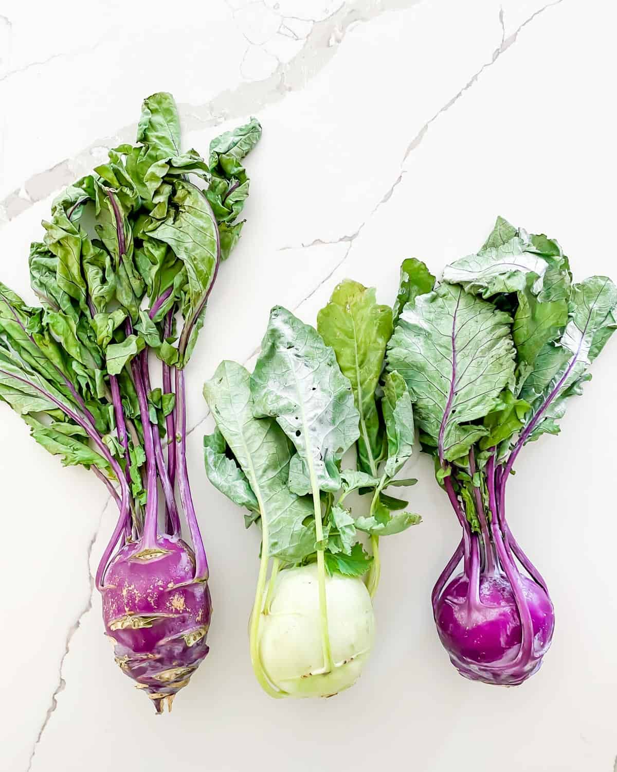 white and purple kohlrabi with stems