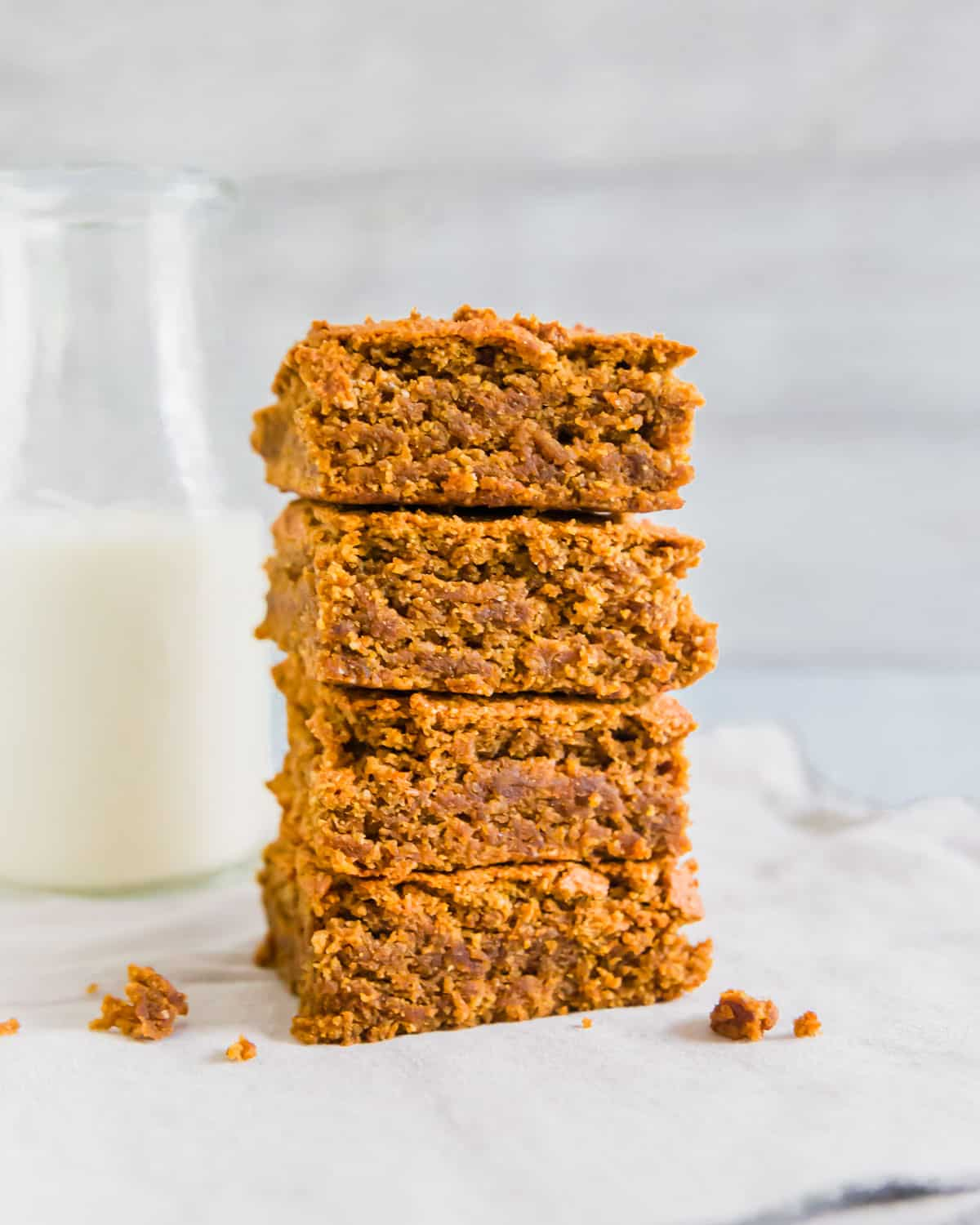Thick, chewy and moist gluten-free, vegan and dairy free pumpkin bars are a delicious fall treat!