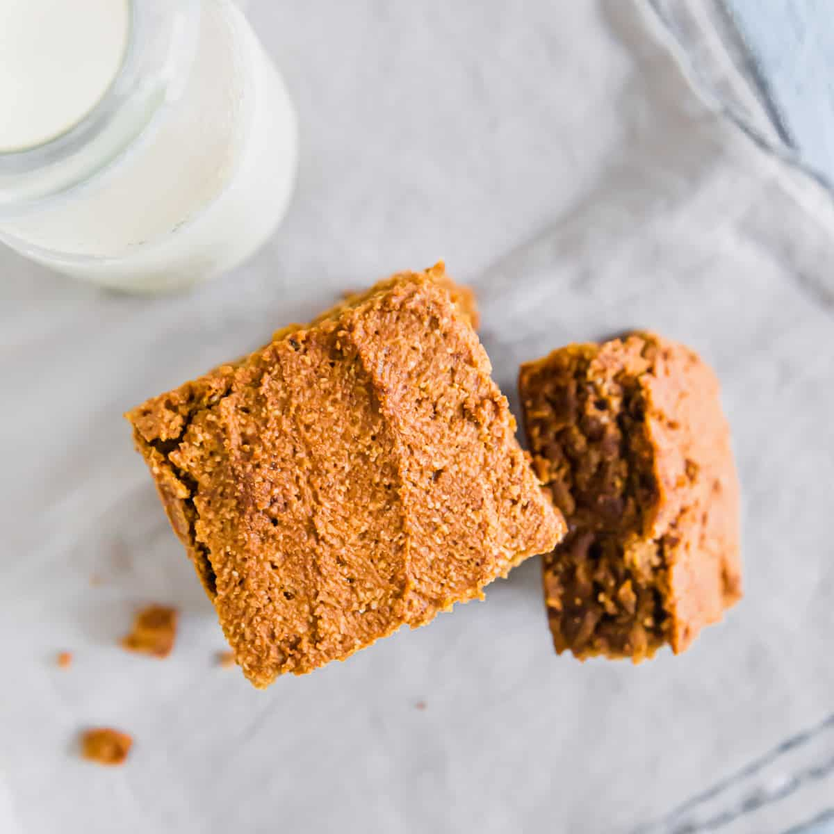 Soft, chewy and moist gluten-free pumpkin pie bars go perfectly with a glass of milk.