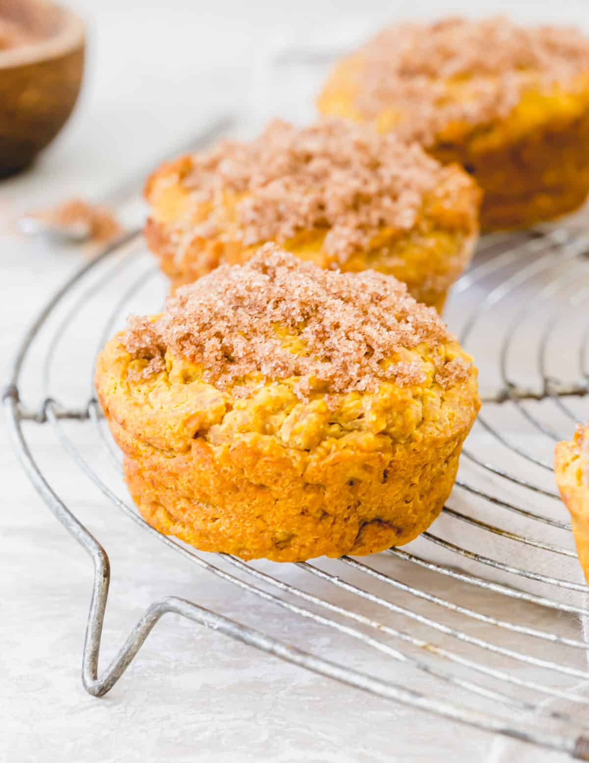 Gluten free pumpkin muffins topped with cinnamon sugar are a deliciously easy fall treat.