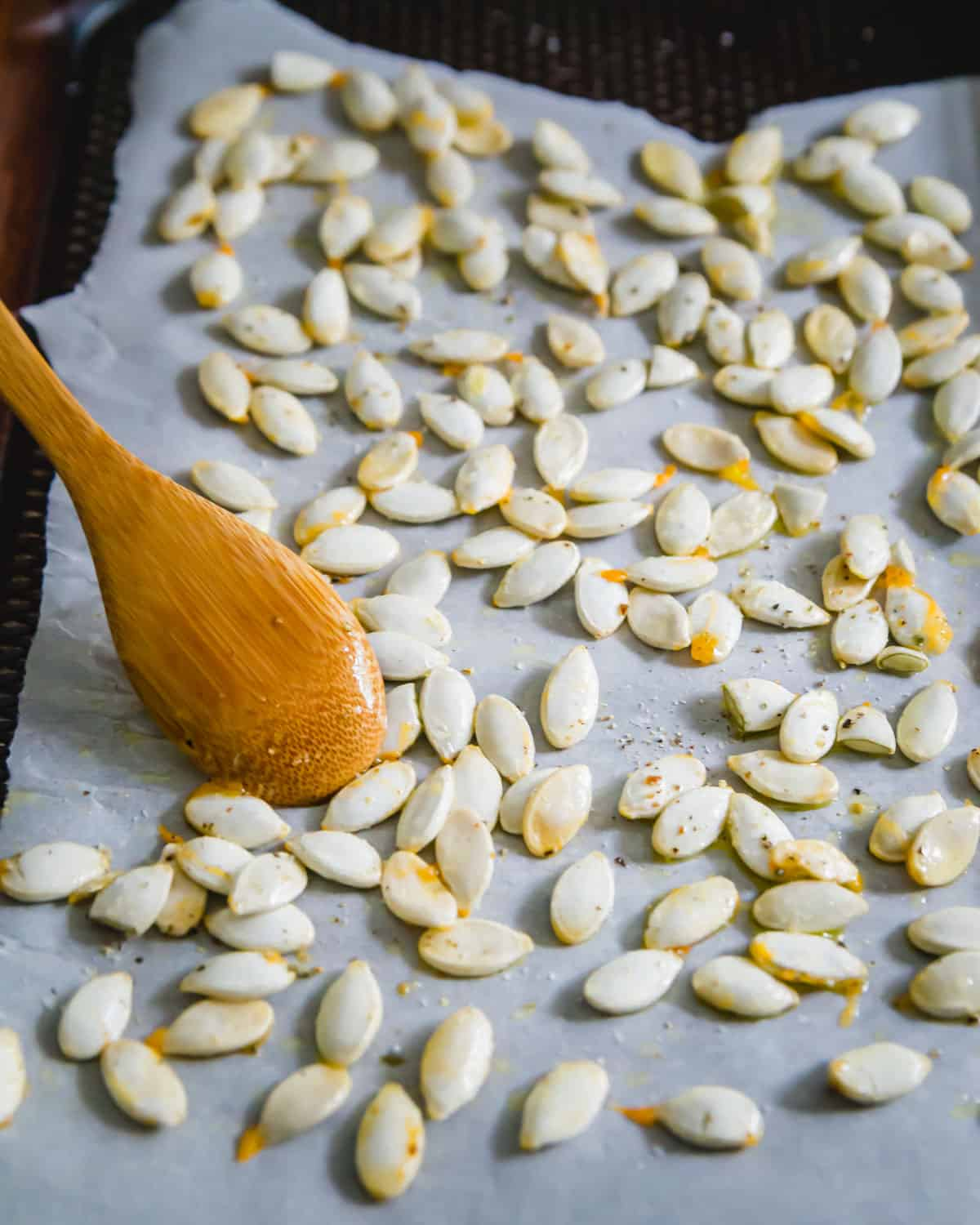 Squash seeds cleaned, seasoned and ready to be roasted in an oven
