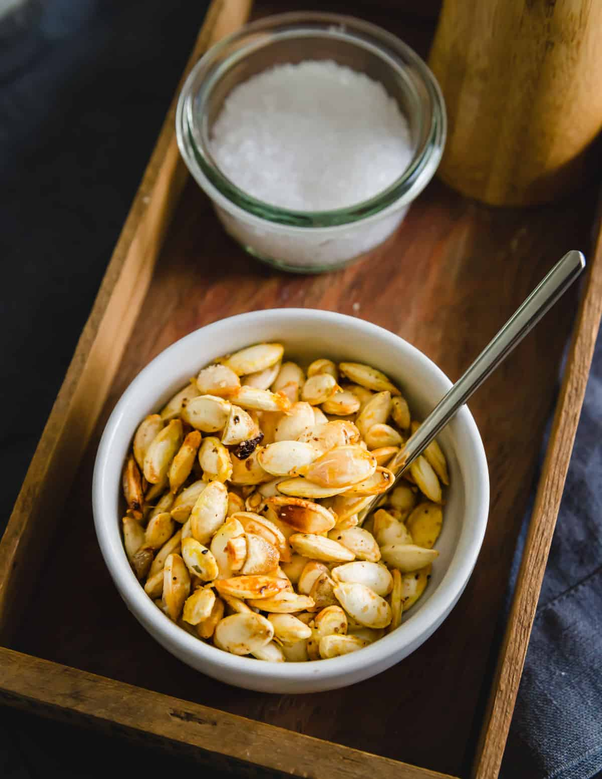 Crispy, golden roasted winter squash seeds seasoned with olive oil, salt and pepper