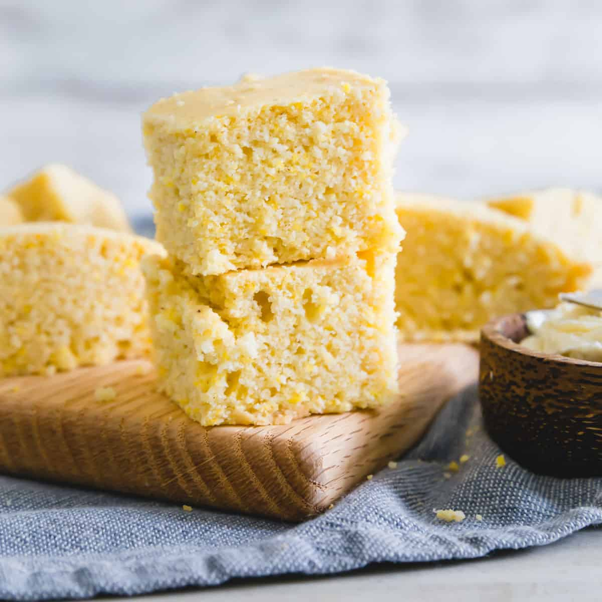 This easy vegan cornbread recipe is also gluten-free! It bakes up moist with the perfect textured cornbread bite and just a hint of sweetness so you can enjoy it with a bowl of chili or soup just as much as with a pat of butter by itself!