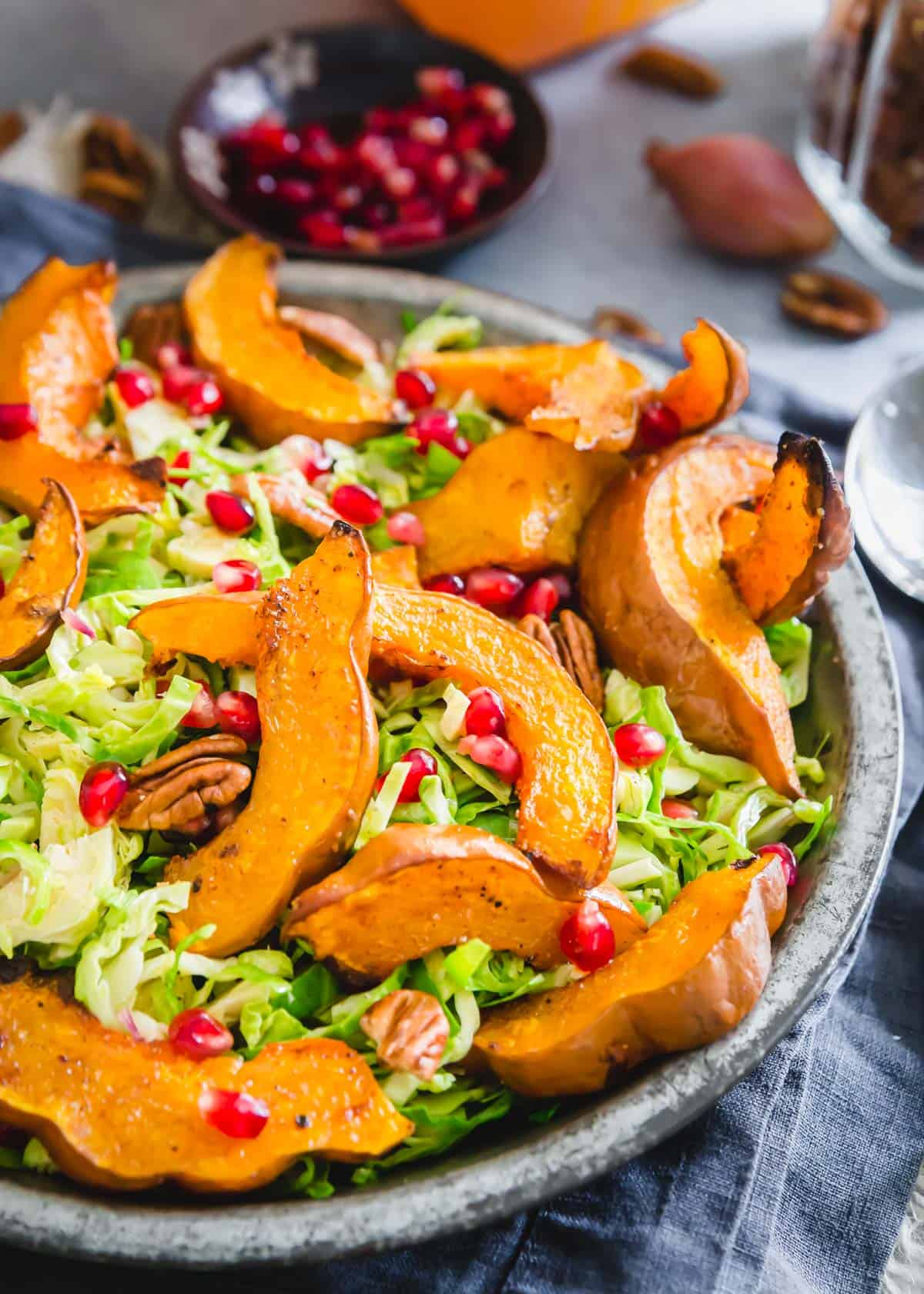 Roasted koginut squash salad with shaved brussels sprouts and pomegranates.