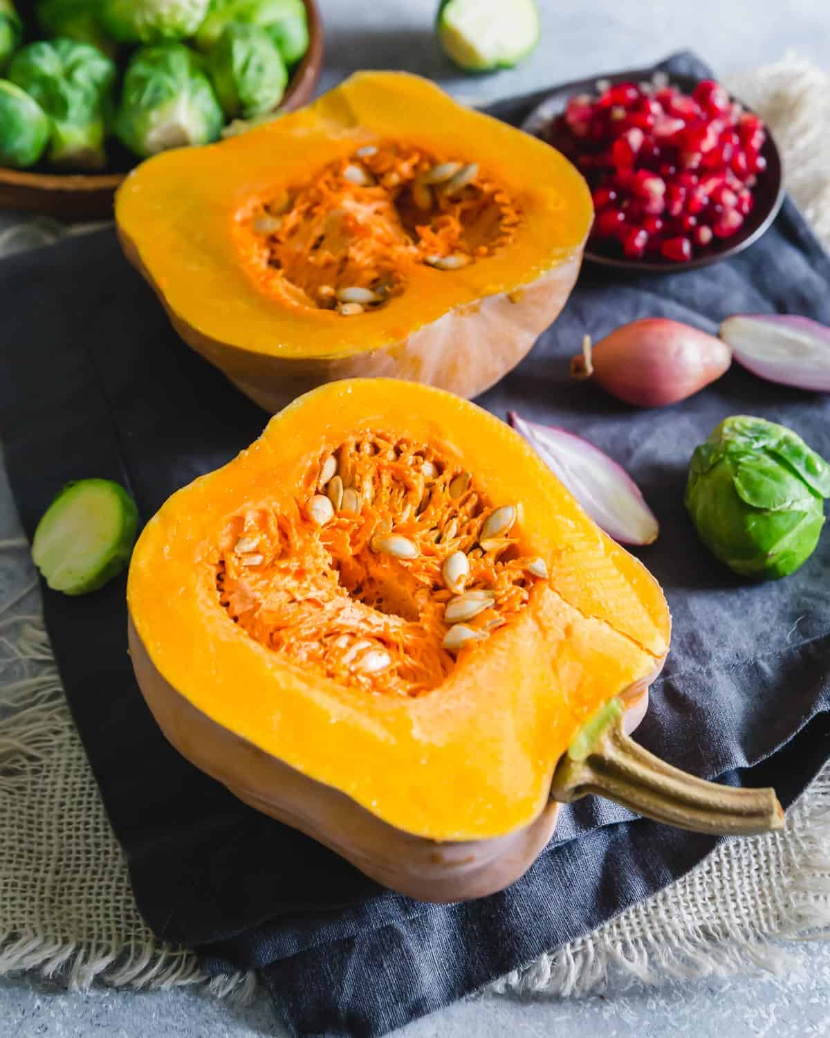 halved koginut squash with seeds