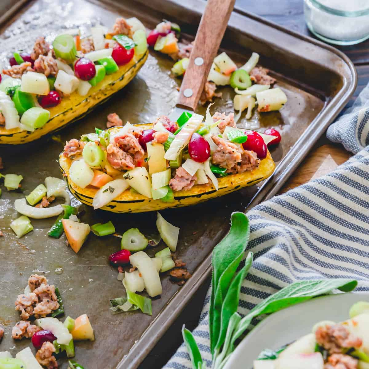Roasted stuffed delicata squash bursting with savory and sweet fall flavors that complement the tender, slightly sweet squash perfectly.