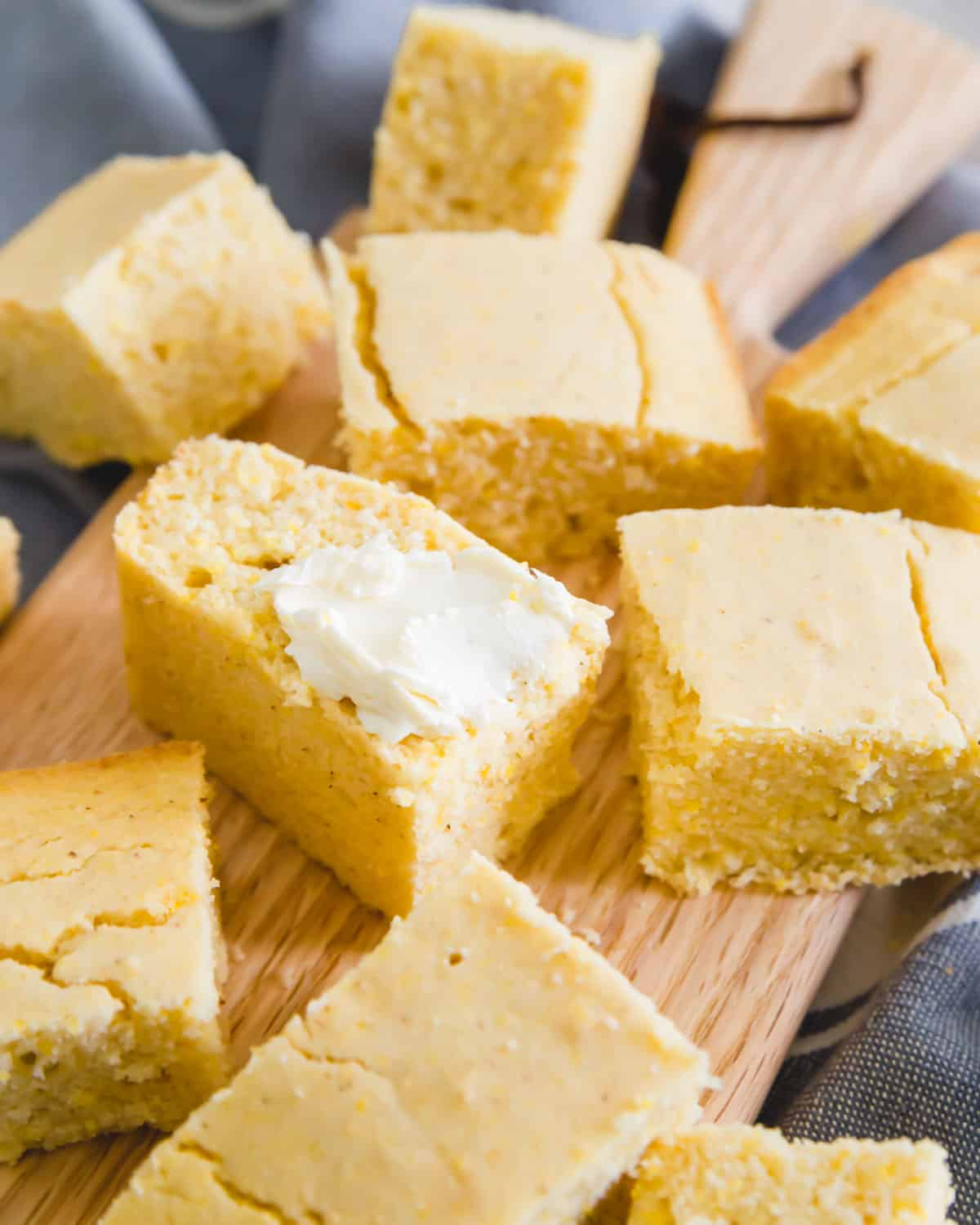 tender vegan and gluten-free cornbread recipe with a smear of soft butter