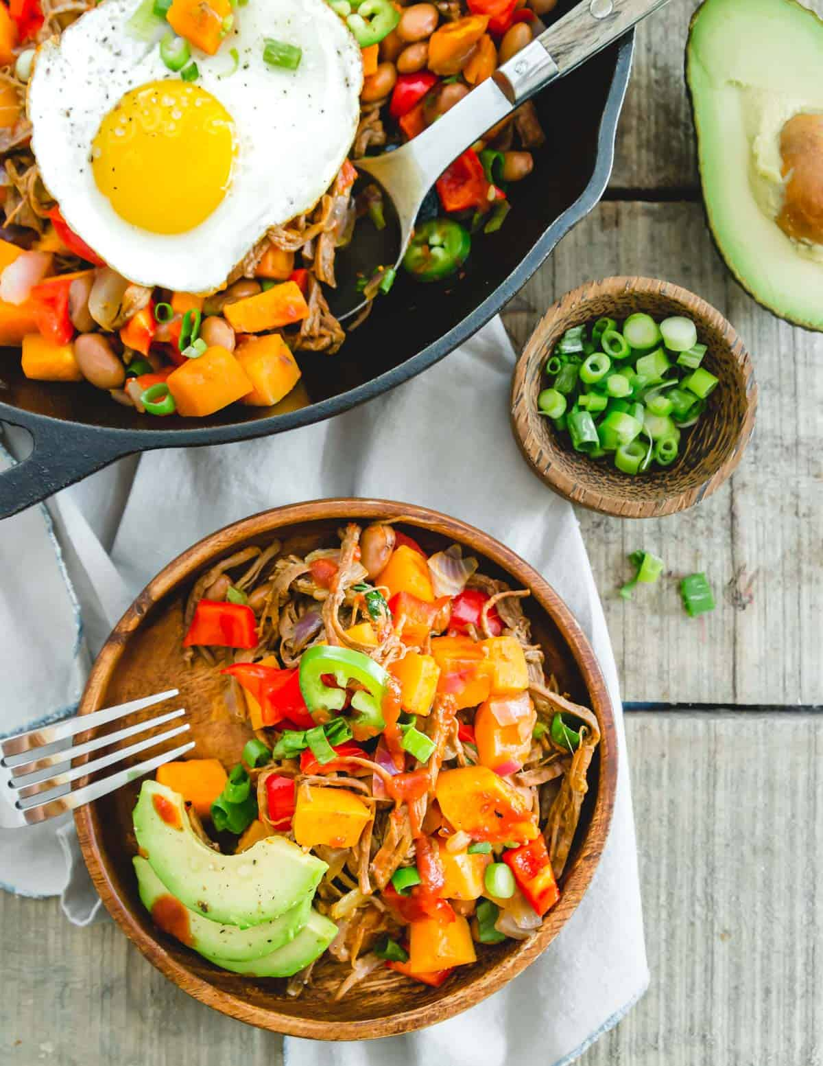 Easy brisket hash recipe using leftover beef brisket served with jalapeños, avocados, green onion and BBQ sauce.