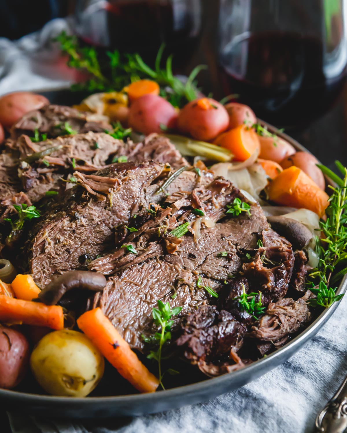 Red wine balsamic venison roast is a simple served with carrots, onions, mushrooms and potatoes and cooked in the Instant Pot until fork tender.