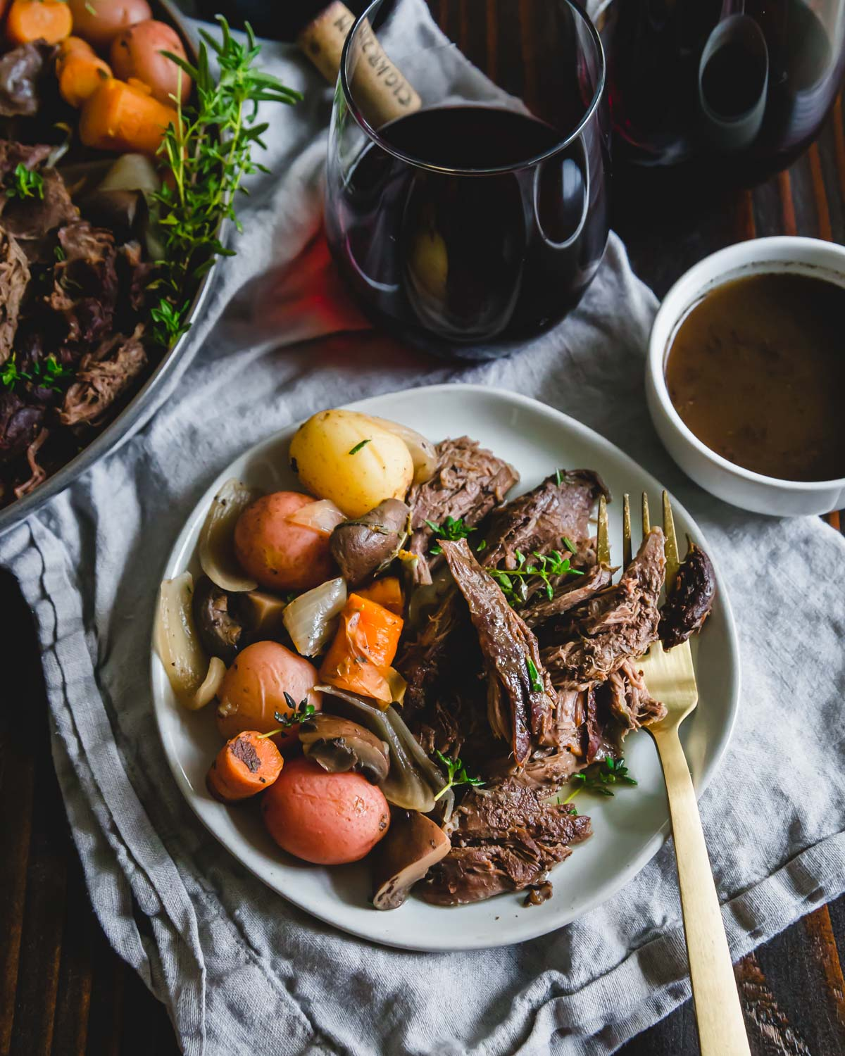 juicy and tender venison roast cooked in the Instant Pot with potatoes, mushrooms, onions and carrots in a red wine balsamic sauce