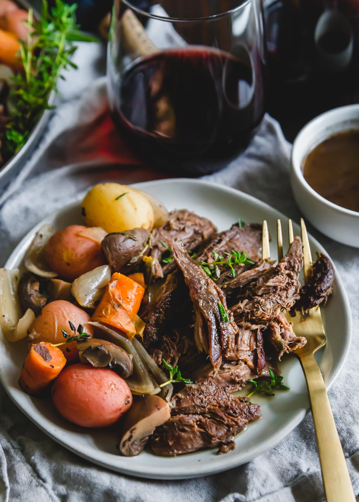 This easy Instant Pot venison roast is cooked along with baby potatoes, mushrooms, carrots and onions for a comforting winter meal all made in one pot.