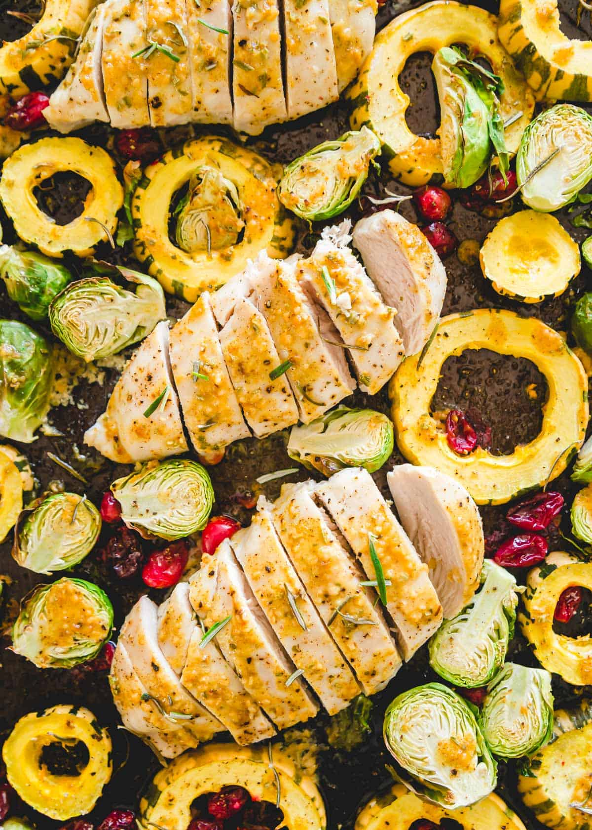 Maple mustard chicken with rosemary and fall vegetables comes together in just 20 minutes on one pan.